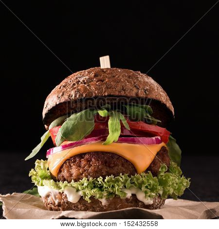 Tasty Grilled Burger With Lettuce And Mayonnaise ,on Blackboard Table