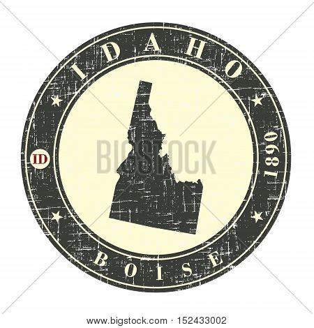 Vintage stamp with map of Idaho. Stylized badge with the name of the State year of creation the contour maps and the names abbreviations . Vector illustration