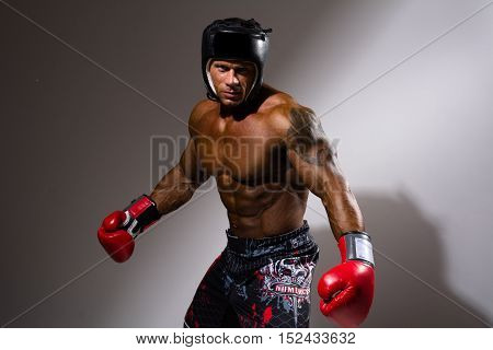 Portrait Of Young Man With Boxing Helmet