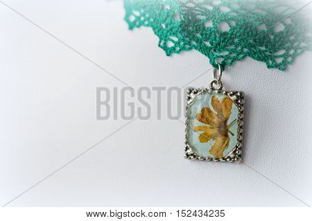 Pendant With Natural Flowers On The Lace Choker Close Up