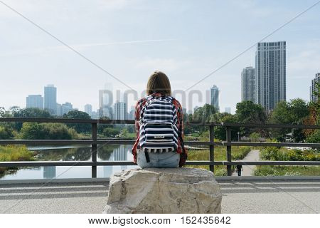 Chicago USA - September 25 2015: Tourist sitting and looking at the skyscrapers of Chicago