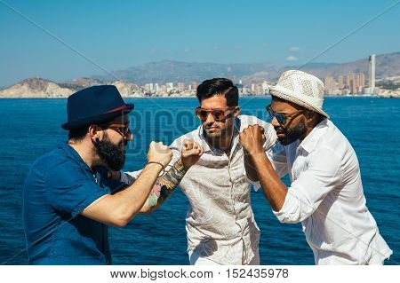 Portrait of stylish men in sunglasses in straw hat depicts a fight