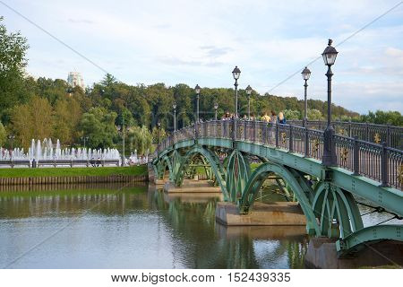 MOSCOW RUSSIA - SEPTEMBER 06 2016: Openwork arch bridge in museum-reserve