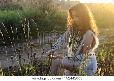 girl in ethnic traditional dress on nature in summer