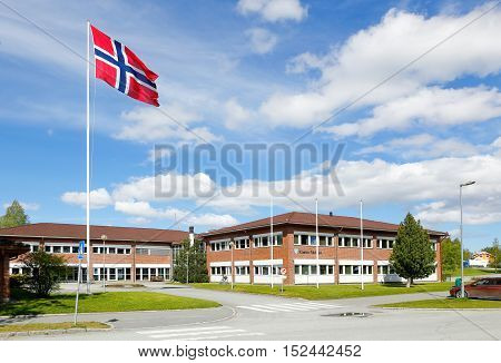 Norway, Klabu - May 30, 2015: The city hall of Klabu municipal with a hoisted Norwegian flag in front of the building.