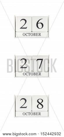 Closeup group of white wooden calendar with black 26 27 28 october word three date calendar isolated on white background