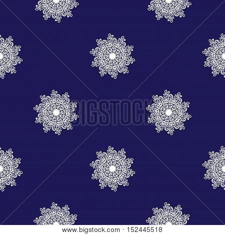 seamless mosaic pattern of small white snowflakes on a dark blue background