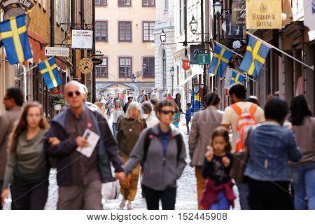 Stockholm, Sweden - July 31, 2015: Unknown people walking the street Kopmangatan in the Old town.