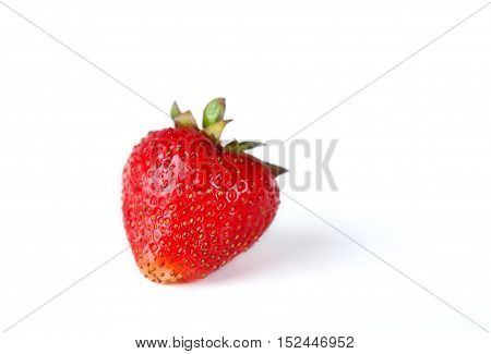 Juicy red strawberry on white background. Close-up.