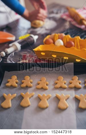 Woman make ginger bread for Christmas at home