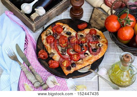 Pizza With Pepperoni, Tomatoes, Mozzarella, On Vintage Wooden Table Background. Valentines Day Conce