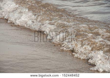 Wave of sea on sandy beach