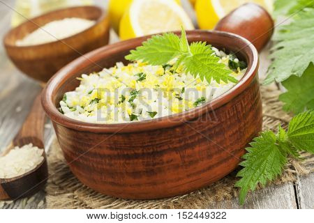 Risotto with nettles and lemon in the ceramic pot
