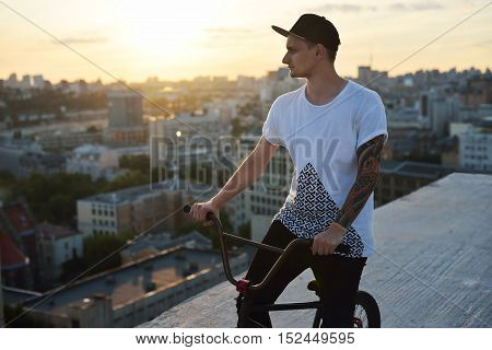 Handsome Young Man Model Biking In The City