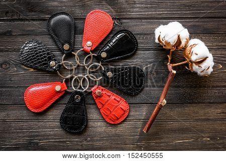 Keys attached to leather keychain , on darken wooden background