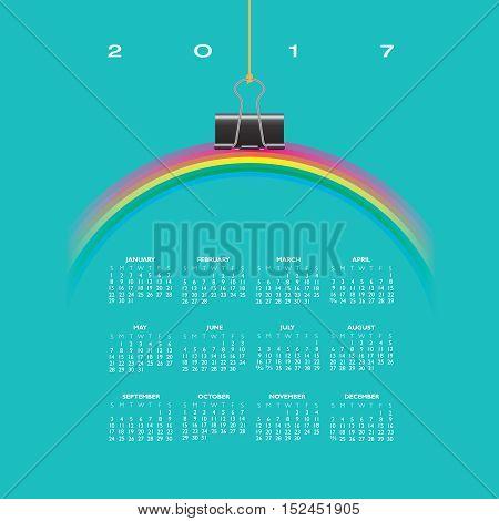 A 2017 Calendar with Rainbow Hung by a Binder Clip