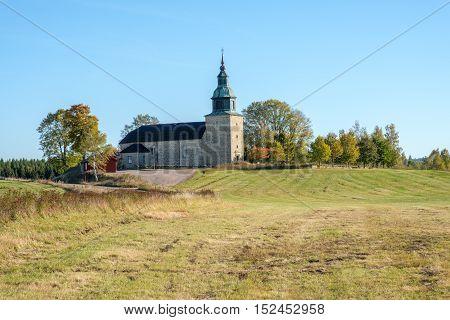 Bjurum church during autumn in the countryside of Vastergotland, Sweden
