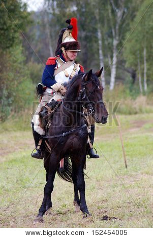 BORODINO MOSCOW REGION - SEPTEMBER 04 2016: Reenactor horse rider dressed as Napoleonic war soldier at Borodino battle historical reenactment in Russia. Color photo.