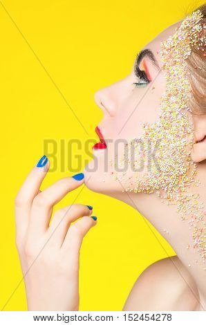Girl with sweets in colorful makeup. Sweet Girl.
