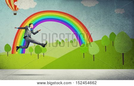 Young businessman running in a hurry, background nature concept