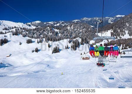 HOCH-YBRIG SWITZERLAND - February 26 2015 - Skiers on ski lift in the Hoch-Ybrig mountain resort Switzerland