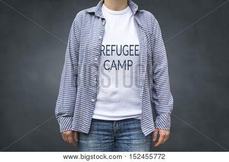 Refugee camp print on t-shirt. Political message.
