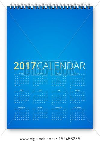 Simple calendar 2017 blue colored template. Week starts from sunday. Vector realistic spiral notepad notebook