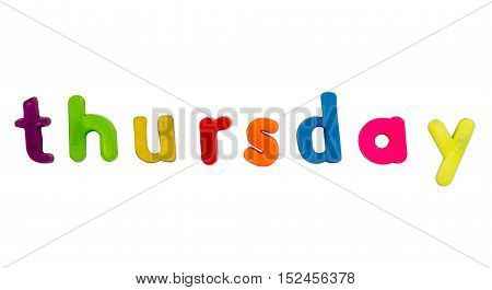 Plastic multicoloured plastic letters with the word Thursday