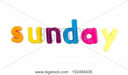 Plastic multicoloured plastic letters with the word Sunday