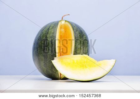Yellow Watermelon On Blue Background