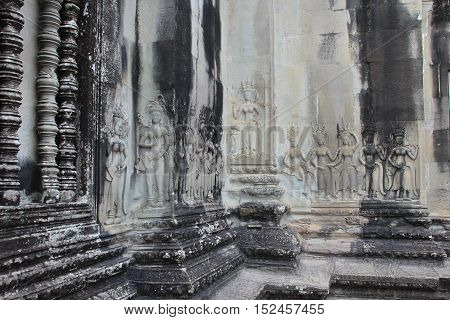 Angkor Wat's bas-relief carved into stone. Angkor Wat, Built by King Suryavarman II in Cambodia