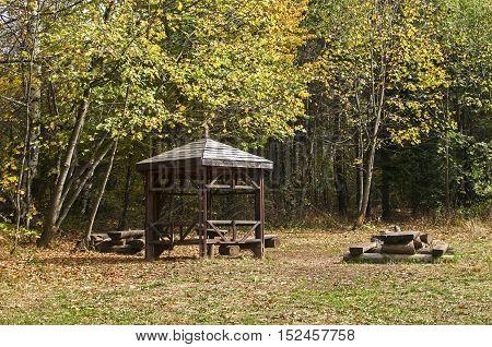 Wooden pavilion in mountain forest park tourist rest area