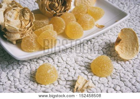 marmalade on a plate sugar marmalade and yellow roses
