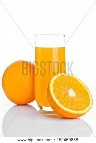 Glass of healthy orange juice with fruit on white background