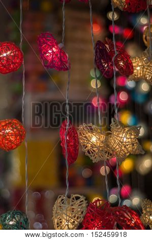 Colorful, illuminated festive lights hanging. Christmas decoration light background.
