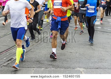 Marathon runners race in city streets blurred motion