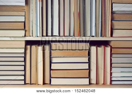 Background from books. Library literature reading. Education back to school. Book shelf.