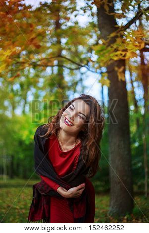 happy excited young woman in the autumn park