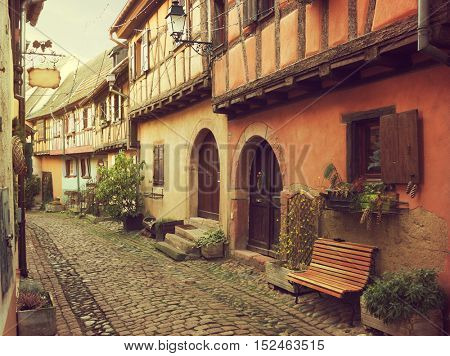 Winding street in Eguisheim, north-eastern France.  Toned image
