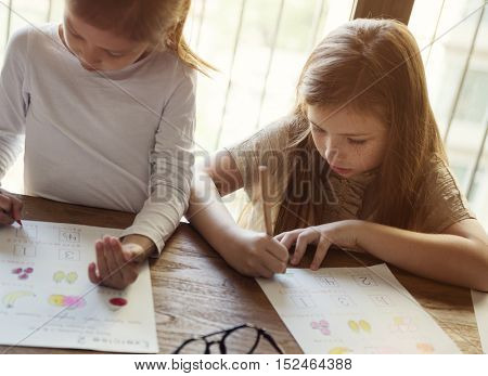 Girls Drawing Homework Study Concept