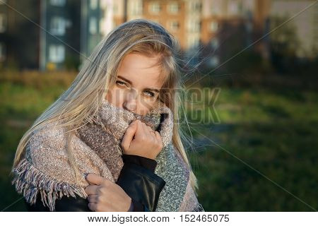 sad pensive blond girl in scarf toned image