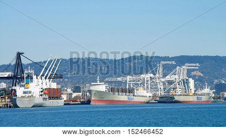 Oakland CA - September 27 2016: Port of Oakland Matson cargo shops waiting for cargo to be loaded. Matson provides shipping services Pacific wide. Mainly to and from the Hawaiian Islands.
