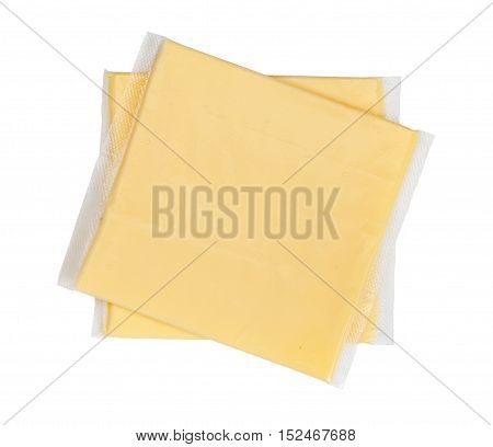 Two Yellow Cheese Slices Packaged On White Background. Close-up, Top View.