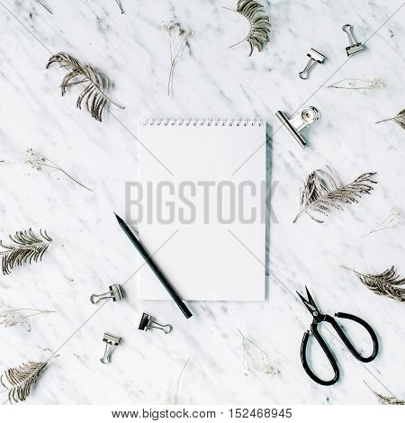 Blank sketchbook on marble background. Flat lay top view office table