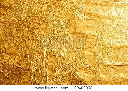 Gold foil texture background. Shiny golden backdrop