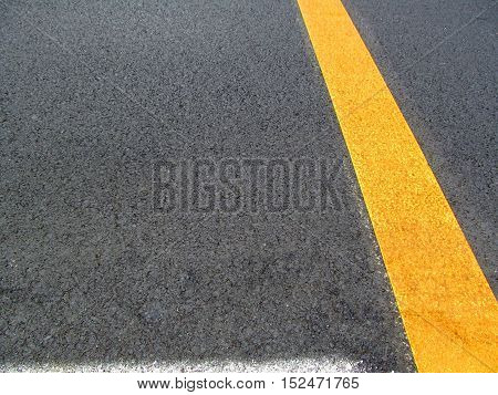 Background asphalt. On asphalt white and yellow stripes