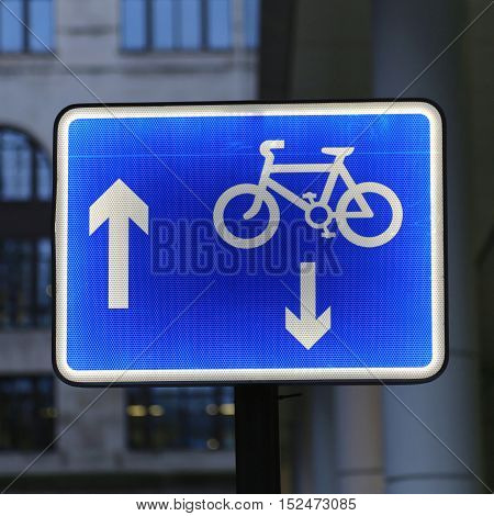 Illuminated Blue Sign With Arrows for Bike Lane