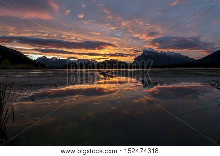 Beautiful sunrise over the rocky mountains at vermillion lake