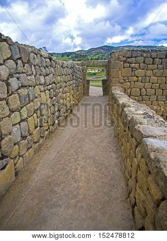 Old hallway at the ancient Inca city ruins of Ingapirca, Ecuador, on an overcast day