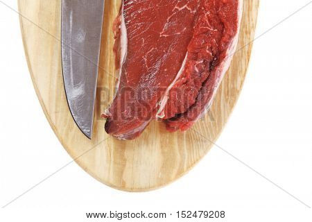 raw meat beefsteak fillet with knife on wood isolated over white background